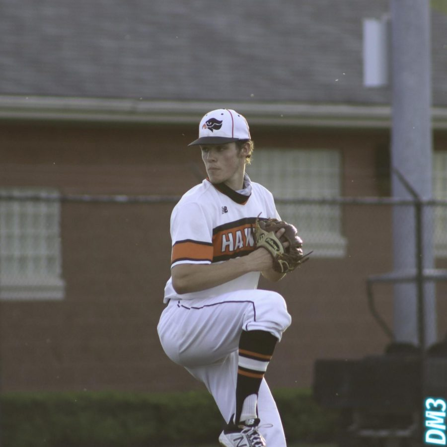 Eric Chalus, Jr. pitches during the Hawks