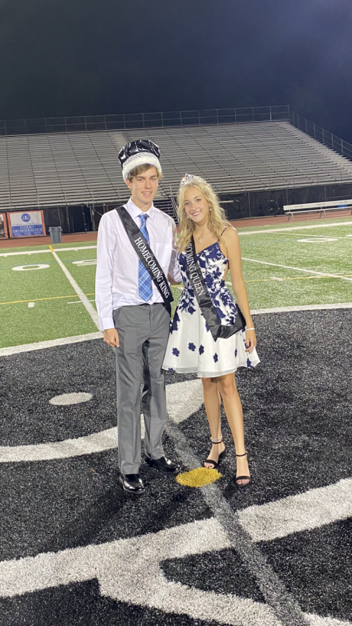 Brooke Veith (Homecoming Queen) stands with Alecko Fekos (Homecoming King) on the 50-yard line.