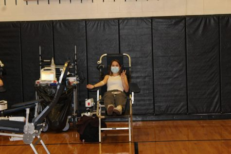 A student donates blood at the Blood Drive on April 8, 2021.