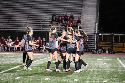Girls celebrate after Lauren Hehs goal to put the Lady Hawks ahead 1-0.
