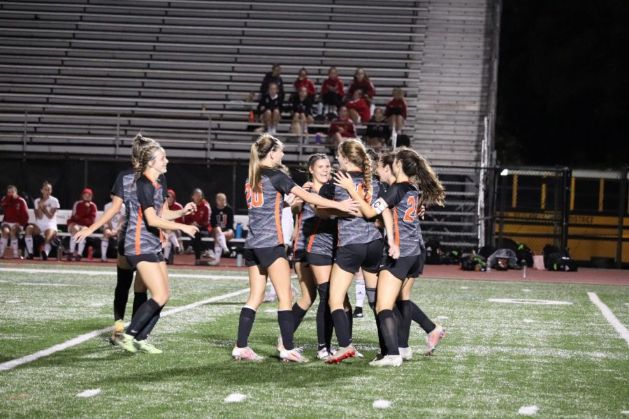 Girls+celebrate+after+Lauren+Hehs+goal+to+put+the+Lady+Hawks+ahead+1-0.